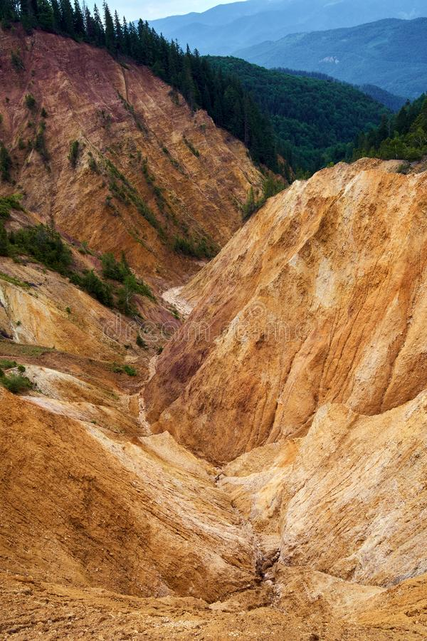 The Rusty Pit in Apuseni, Romania. Erosional view of Ruginoasa Pit from Apuseni mountains, Romania royalty free stock photo
