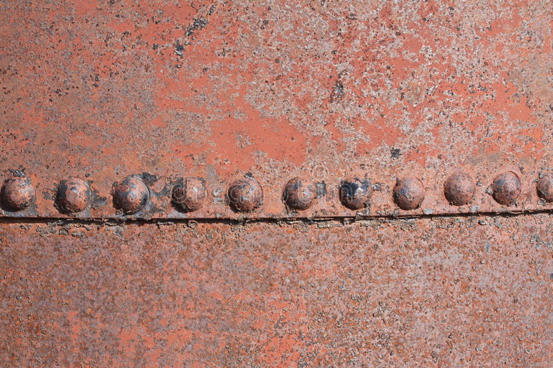Rusty Plate with Rivets stock photo
