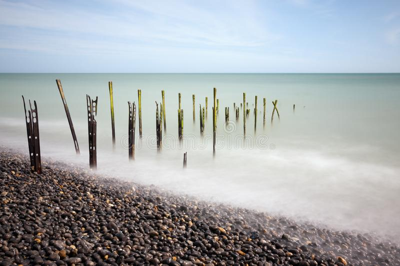 Rusty Posts on Beach royalty free stock photography