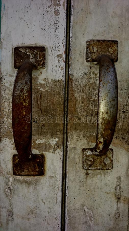 A rusty pull on the door, on the door of the house royalty free stock photography