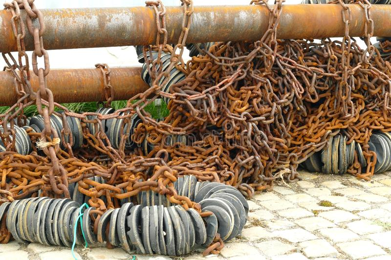 Rusty pull rods of a trawl net stock photography