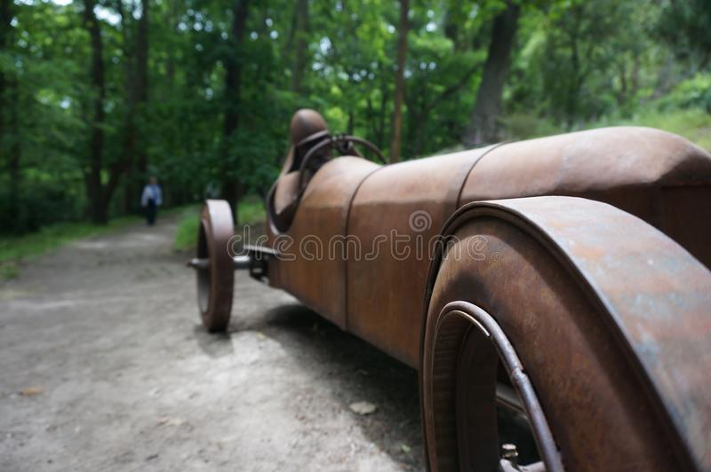 Rusting Car Art racing to the finish line royalty free stock photography