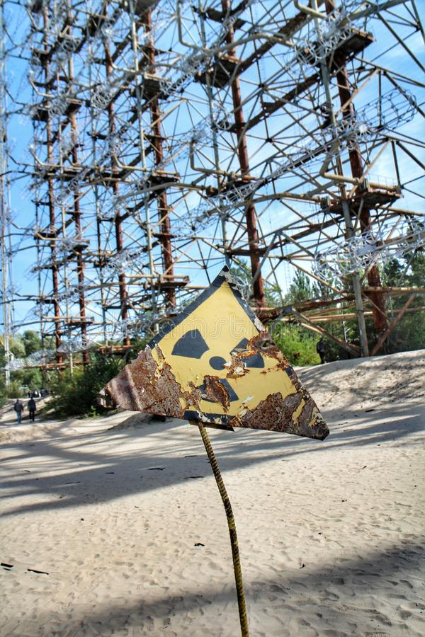 Rusty radioactivity warning sign in the Chernobyl exclusion zone royalty free stock images