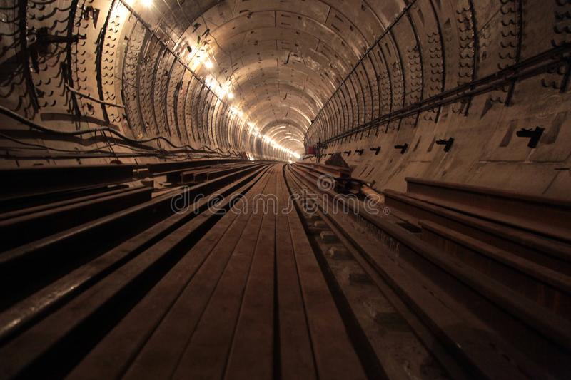 Rusty rail in the subway tunnel royalty free stock photos