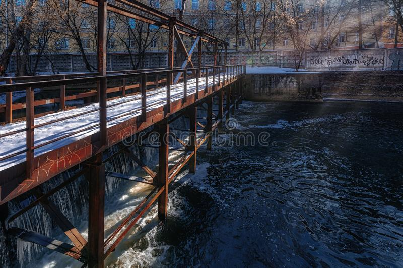Rusty railings of the dam on a Sunny winter& x27;s day stock photos