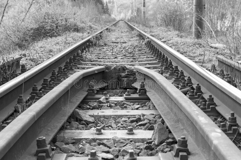 Rusty rails. It has its rusty rails in black and white royalty free stock image