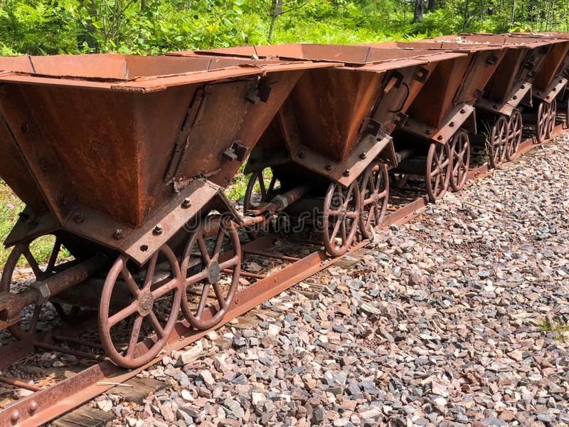 Rusty metal miner carts royalty free stock photography
