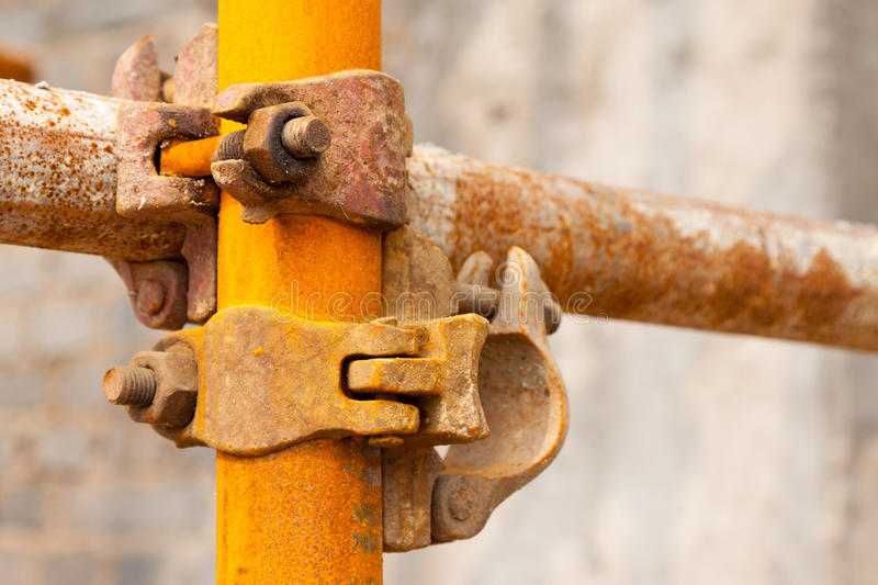 Rusty scaffold in a construction site. Closeup of rusty scaffold in a construction site stock image