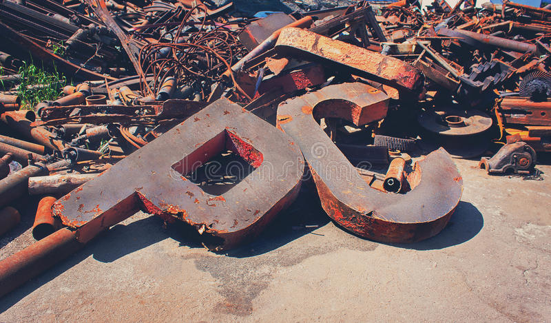 Rusty scrap metal in the yard. A symbol of the Soviet era stock images