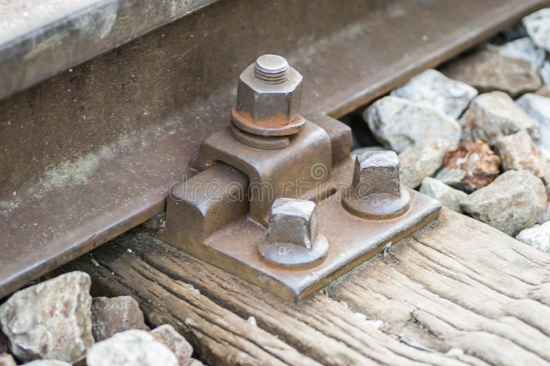 Steel screws on wooden sleepers railroad royalty free stock photography