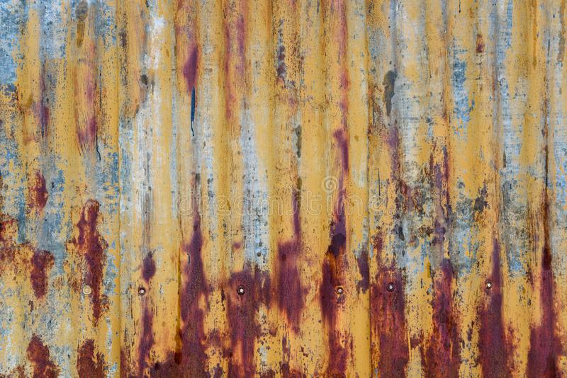 Rusty sheet of corrugated metal wall, as a textured background stock images