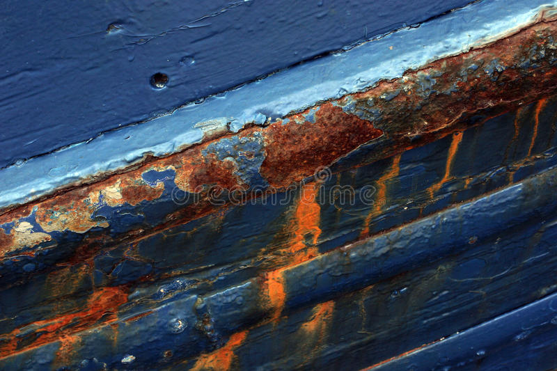 Rusty ship. Close-up of an old abandoned boat with peeling paint royalty free stock photography