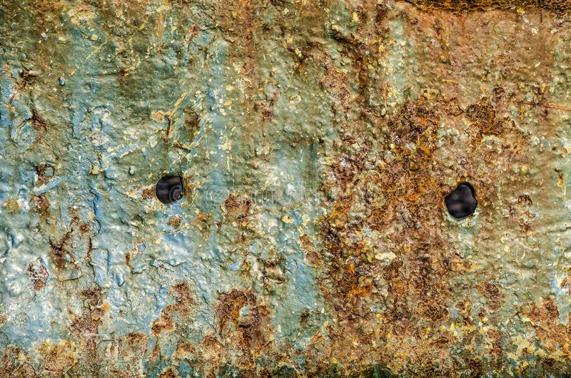 Rusty ship hull with two holes stock photos