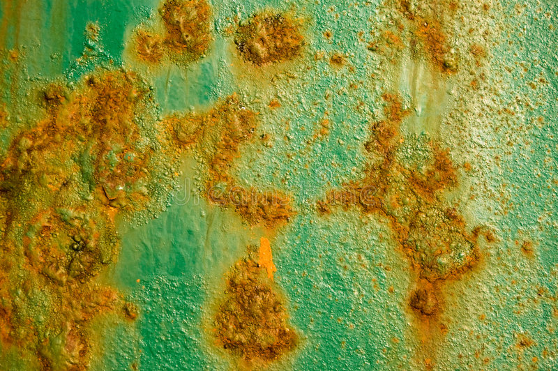 Rusty stained metal with eroded texture stock photography