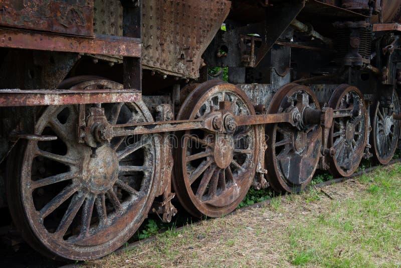 Rusty steam locomotive wheels stock photography