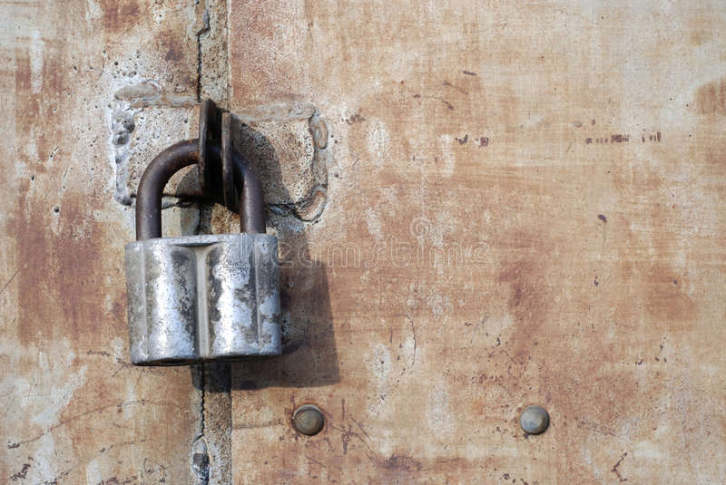 Rusty steel doors locked with padlock. Old painted rusty steel doors locked with padlock stock photos