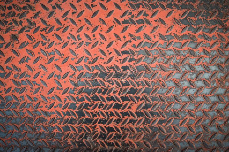 Rusty steel plate texture background. Background of metal diamond plate in grungy royalty free stock images
