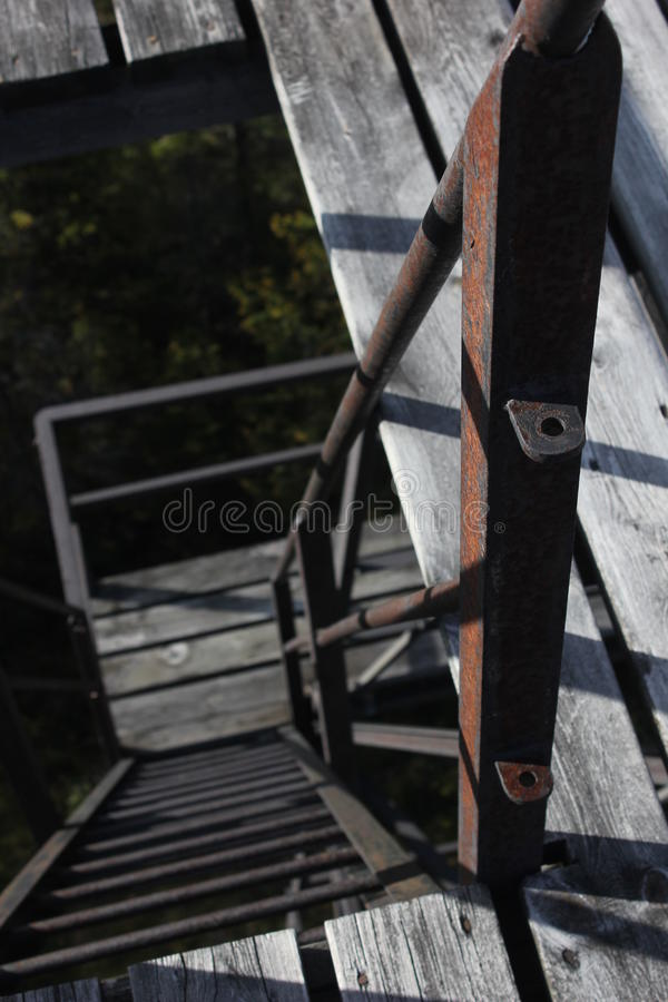 Rusty steps. Looking down on steep and rusty ladder steps royalty free stock photography