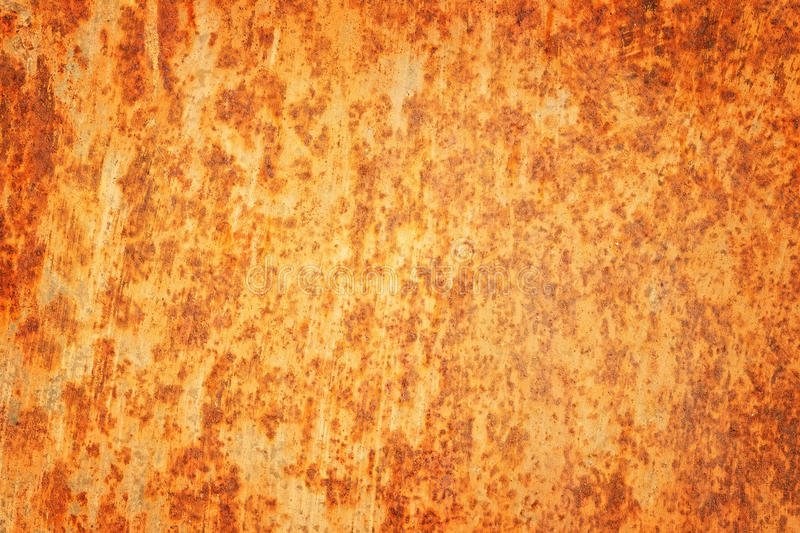 Rusty textured metal background. Cracked rusty metal wall. royalty free stock images