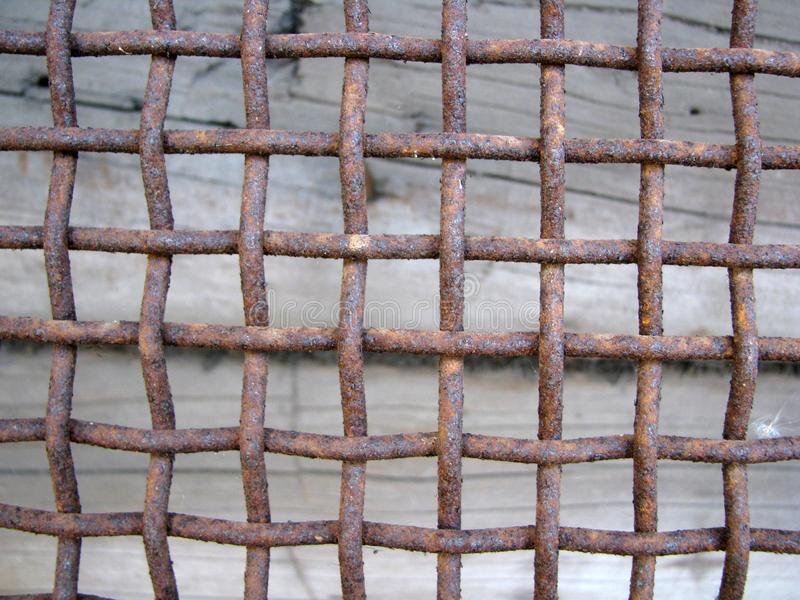 Rusty thick heavy intertwined metal vintage ancient grid stock image