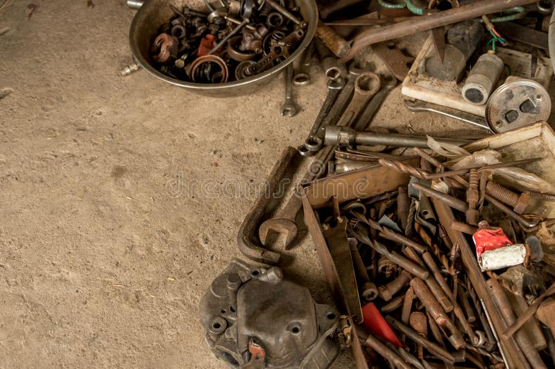 Rusty Tools on Dirty Concrete Floor - Rusty Toolbox - Messy Wrenches/ Spanners - Metal Bowl of Nuts and Bolts. Greasy Tools on Dirty Concrete Floor. Messy Garage stock images