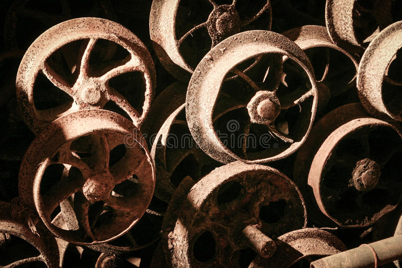 Rusty train wheels. Old, rusting train wheels left abandoned in a long forgotten mining pit. Abstract full-frame background texture stock photos