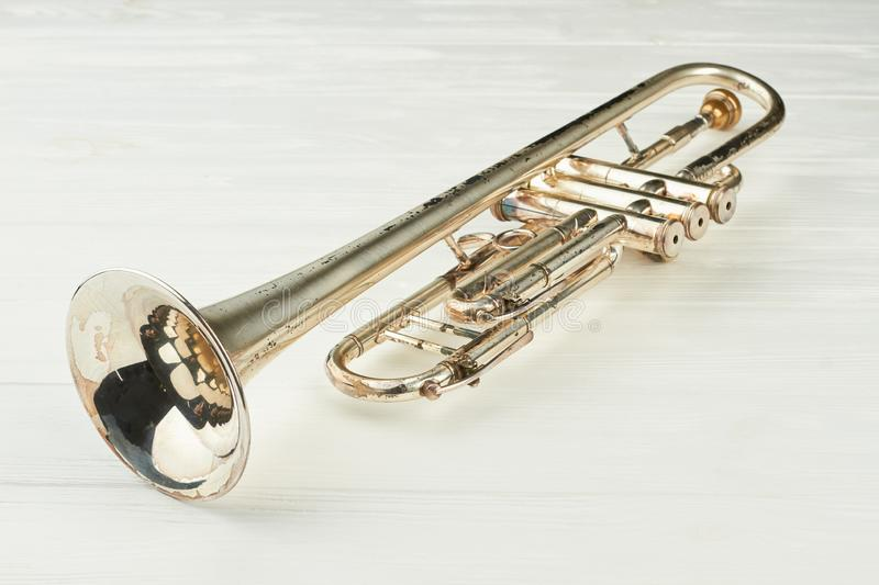 Rusty trumpet on light background. stock images