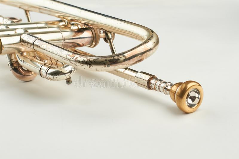 Rusty trumpet with mouthpiece close up. royalty free stock photos