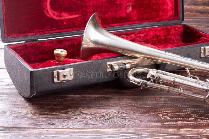 Rusty trumpet and red velvet case. royalty free stock photo