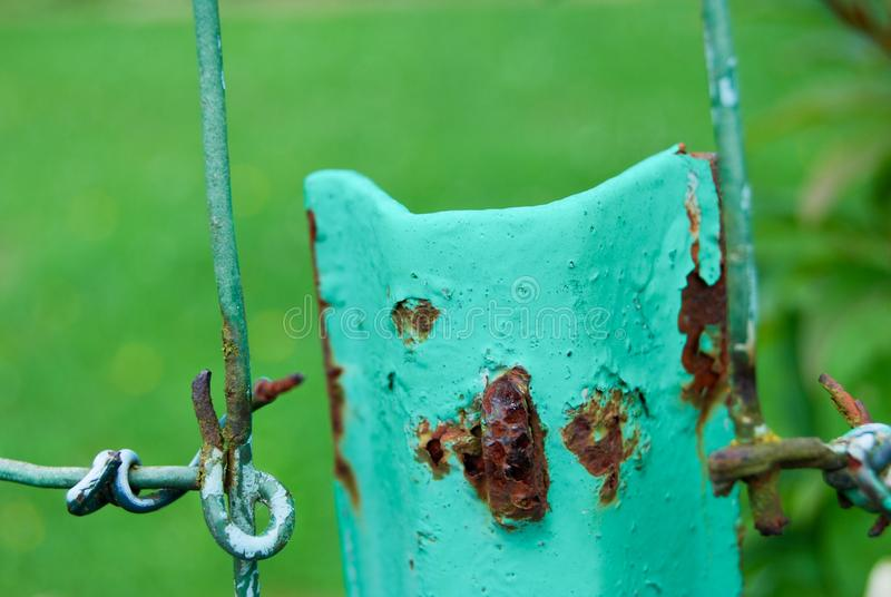 Rusty and twisted wire on a fence in a countryside field royalty free stock images
