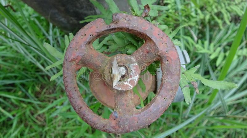 A rusty valve, no one has touched it for a long time. A beautiful background image stock photo