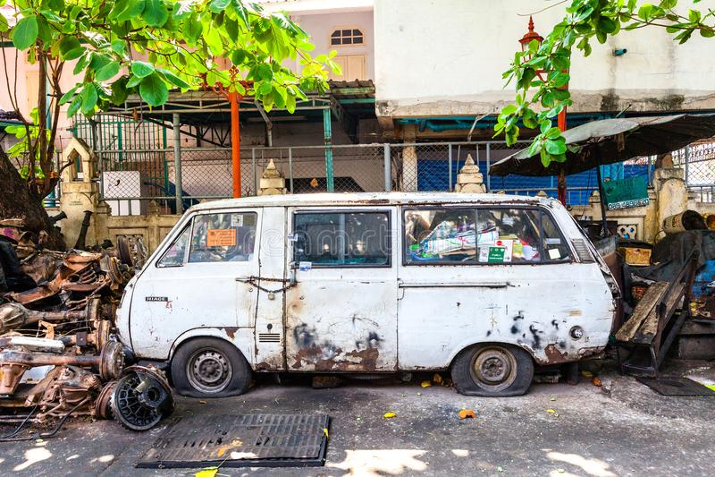 Rusty van on the street of Bangkok stock photo