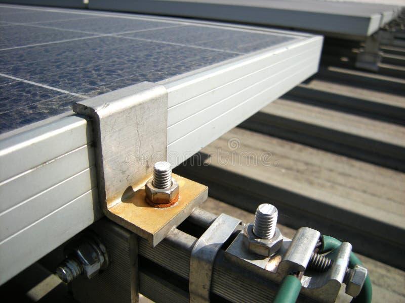 Rusty Washer del materiale solare di torto del morsetto dell'estremità immagine stock libera da diritti