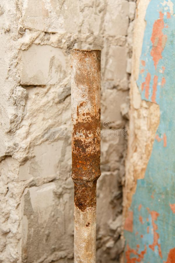 Rusty water pipe after thirty years of operation. stock photo