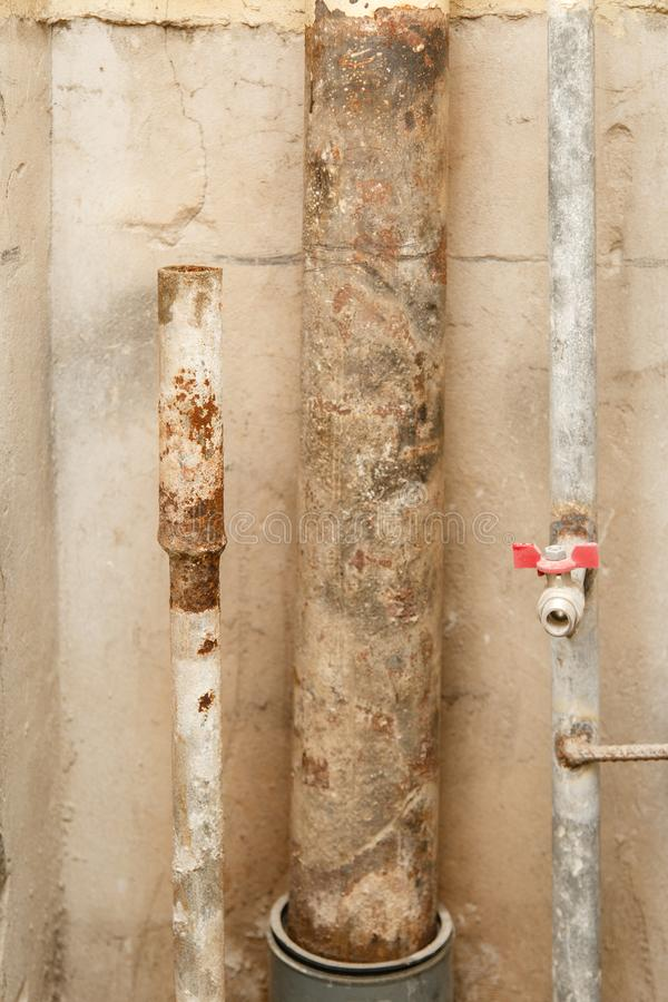 Rusty water pipe after thirty years of operation. stock photos