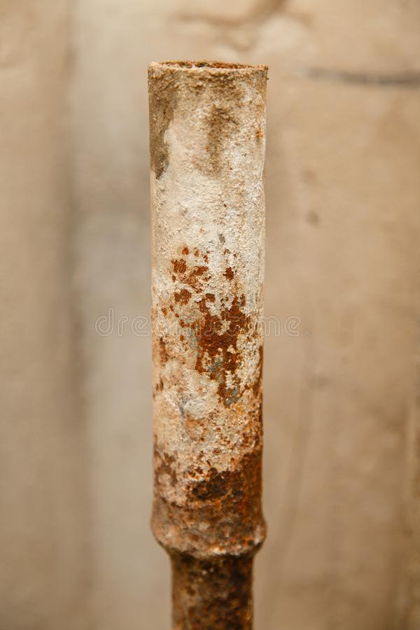 Rusty water pipe after thirty years of operation. Corrosion inside a pipe. Water filter. Replacement of water supply. Repair in a bathroom. Old pipes of stock photography