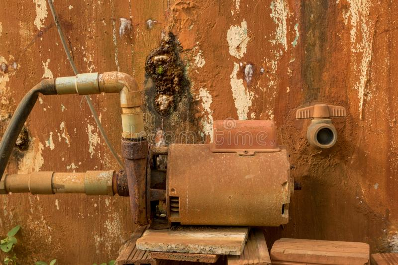 Rusty Water Turbine Generator - Moldy Peeled Concrete Wall Texture/ Vintage Garden stock images