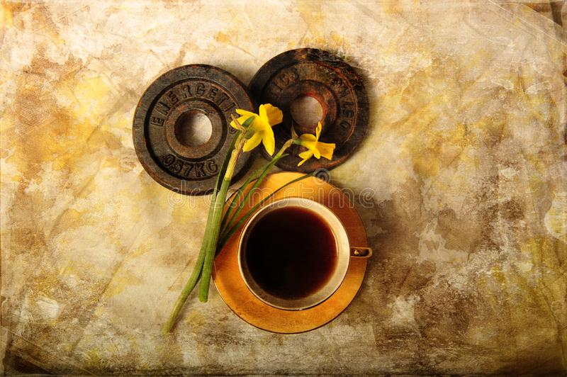 Rusty Weight Plates, Coffee and Daffodils royalty free stock photo