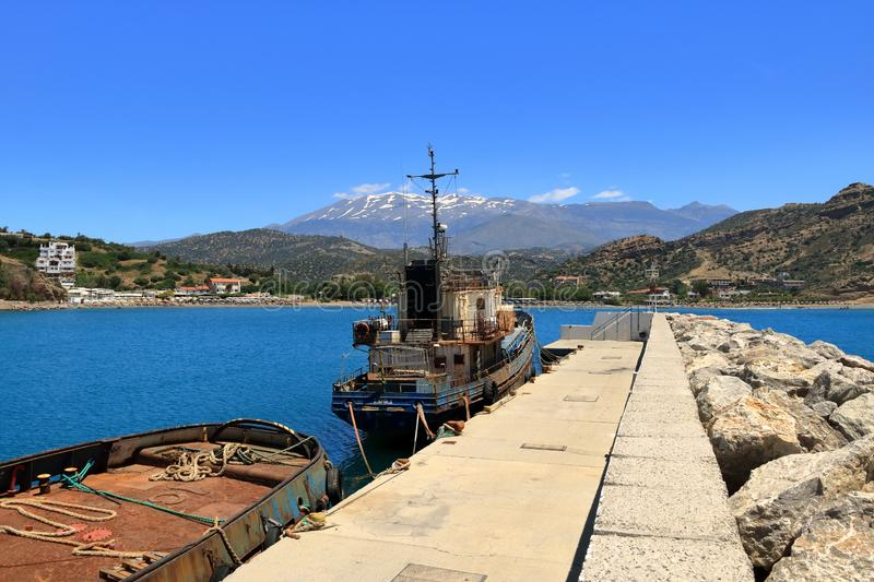 The rusty wreck of two vessels in agia Galini in Crete, Greece stock images