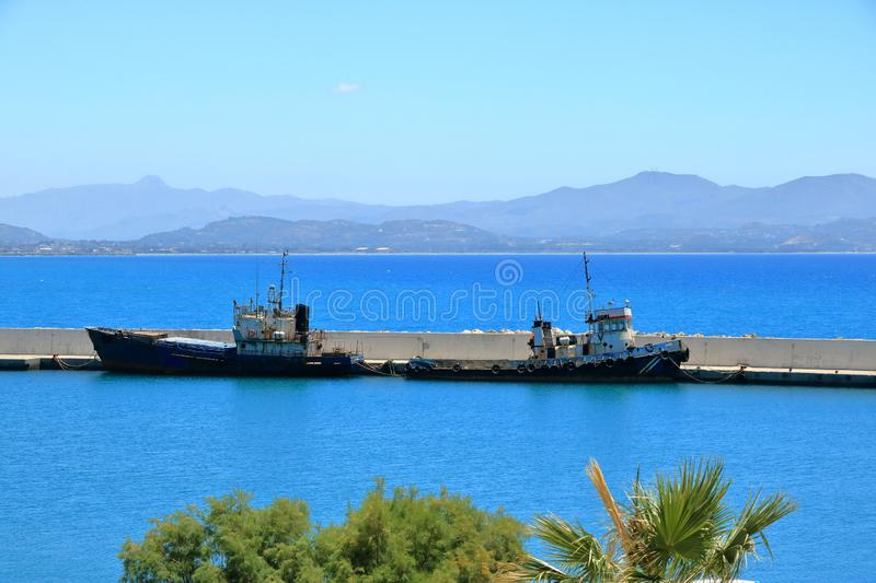 The rusty wreck of two vessels in agia Galini in Crete, Greece royalty free stock photography