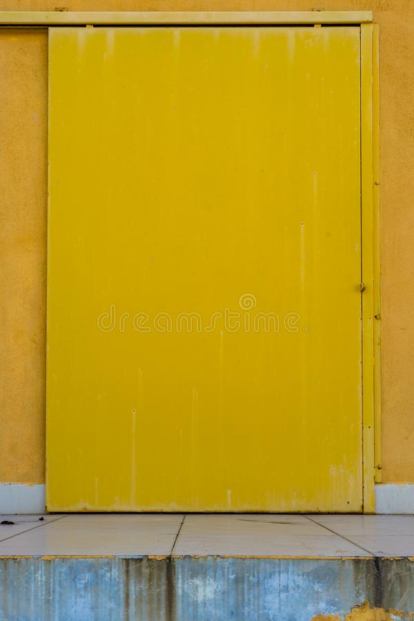 Rusty yellow metal doors vintage style texture. Old texture background stock photo
