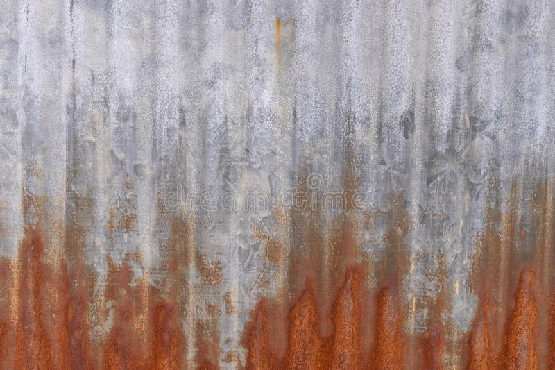 The rusty Zinc galvanised iron as a wall and fence. Background. The rusty Zinc galvanised iron as a wall and fence. use for Background royalty free stock photos