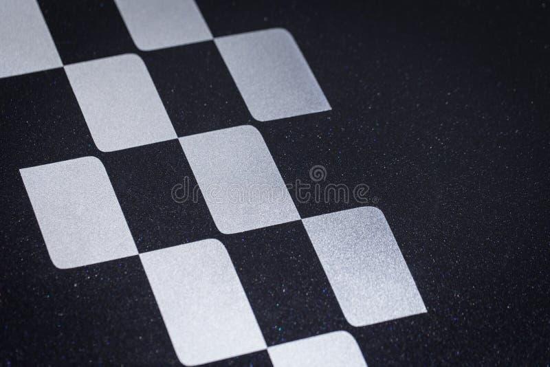 Rutig för springa för bil korsad eller fullföljandeflaggamodell royaltyfri foto