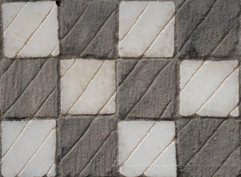 Rutig grå färg- och vitstentextur royaltyfri bild