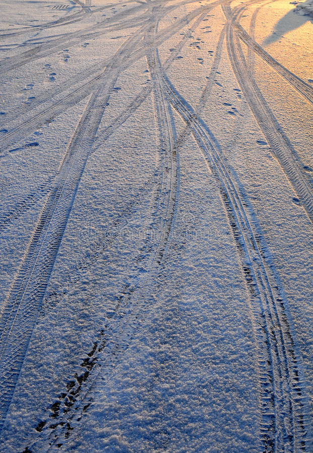The ruts in the snow. Messy ruts and footprints left on the road stock photography