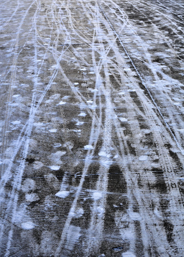 The ruts in the snow. Messy ruts and footprints left on the road royalty free stock image