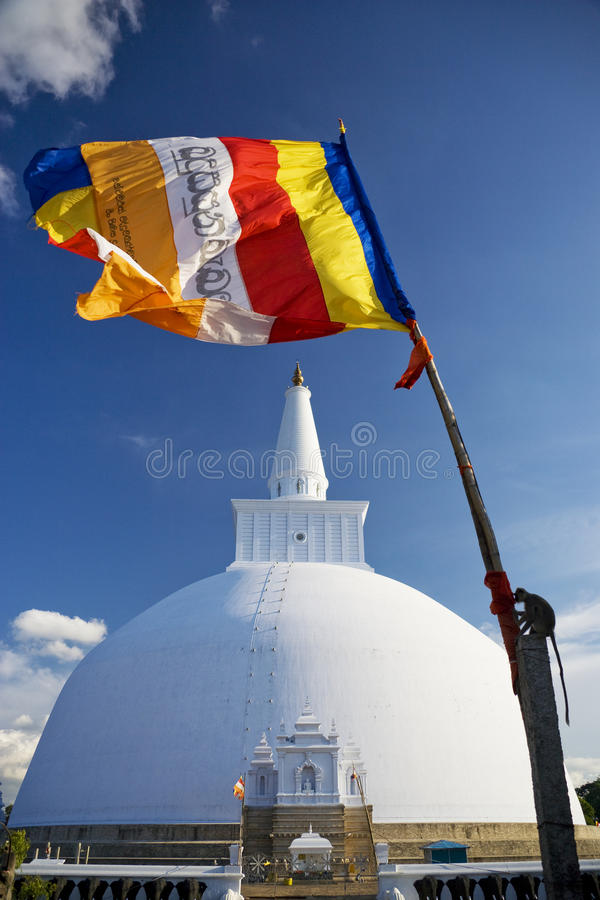 Ruvanveli Dagoba, Anuradhapura, Sri Lanka. Image of UNESCO's World Heritage Site of Ruvanveli Dagoba together with a Buddhist flag, located at Anuradhapura, Sri stock images