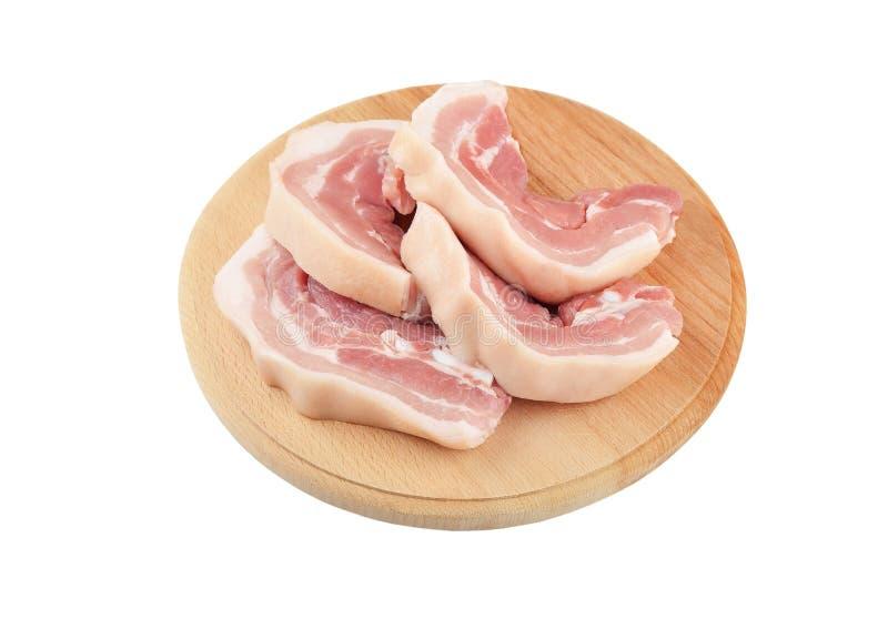 Ruw baconlapje vlees stock foto's