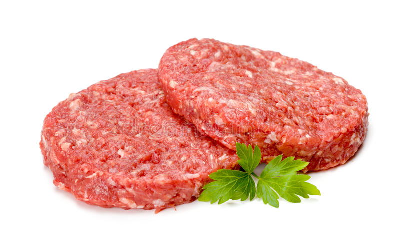 Ruw hamburgervlees op wit royalty-vrije stock afbeeldingen