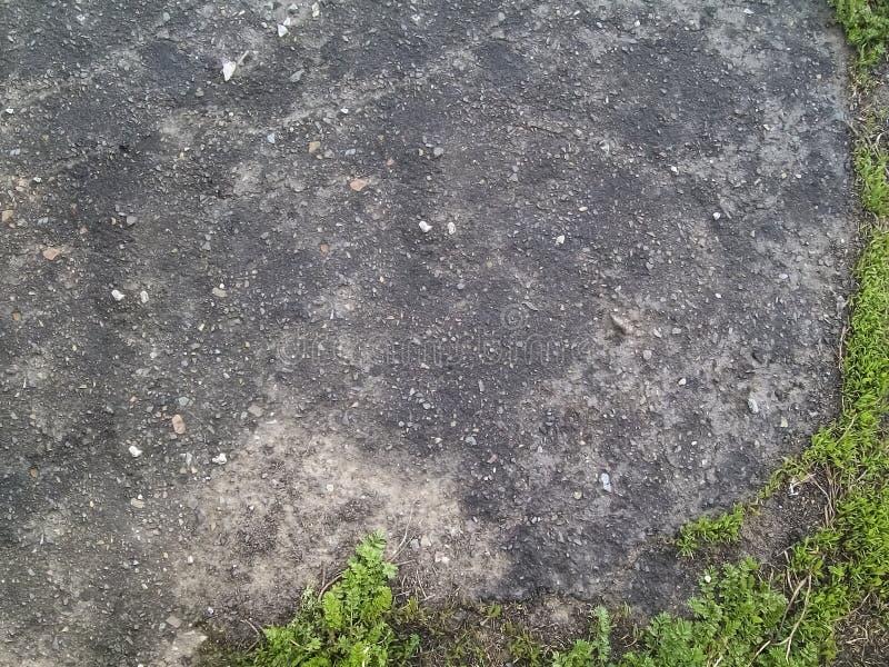 Ruw steenachtig ruw asfalt royalty-vrije stock foto